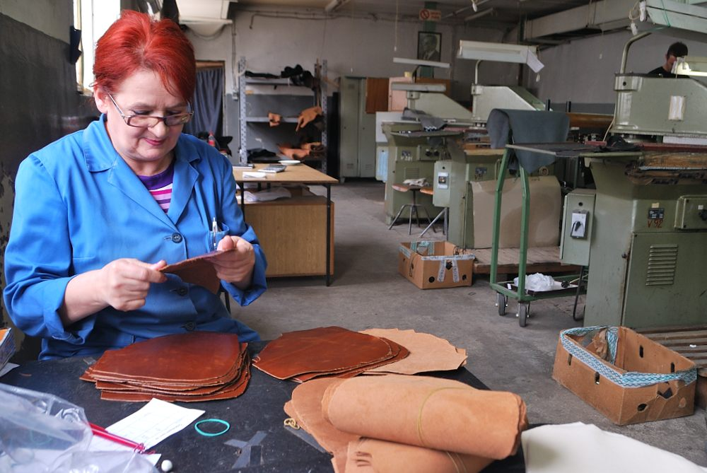 Part of the work of Mrs. Stevanoska is to check the cutting of leathers